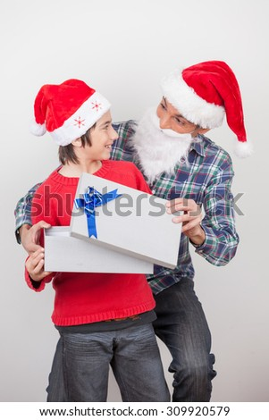 People celebrating Christmas with red classic hat.