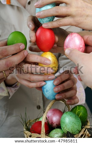 people celebrating easter with traditional eggs
