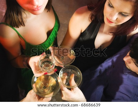 People celebrating with wine and champagne - stock photo