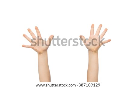 people, childhood, gesture and body parts concept - close up of little child hands raised up - stock photo