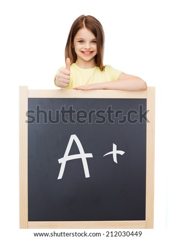 people, childhood, school, gesture and education concept - smiling little girl with blackboard showing thumbs up - stock photo