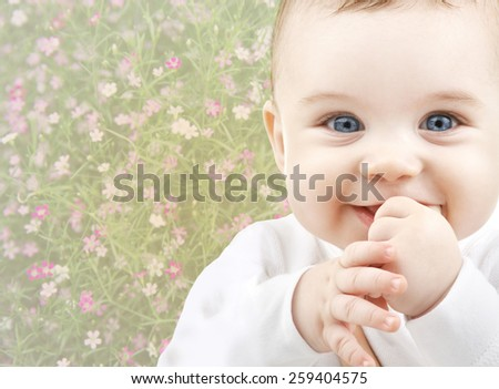 people, childhood, spring and happiness concept - close up of happy smiling baby over floral background - stock photo