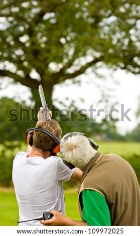 People clay shooting on the shooting range - stock photo