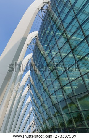 People clean the glass during the day. - stock photo