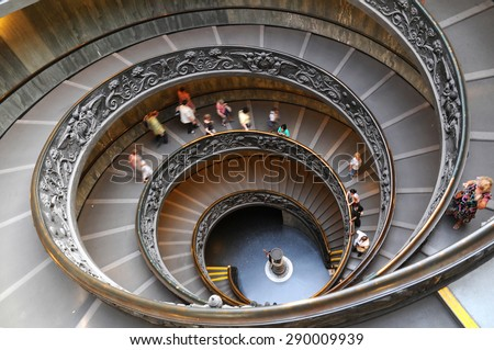 People climbing down the stairs of the Vatican Museums in Vatican, Rome, Italy - stock photo