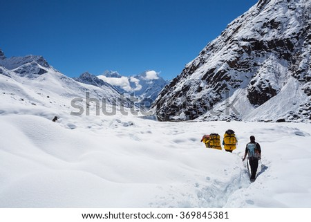 People climbing in the huge mountains in Himalayas - stock photo
