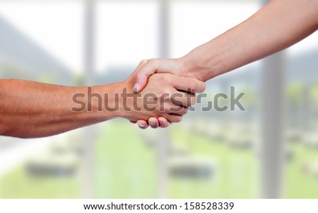 People closing a deal with a handshake - stock photo
