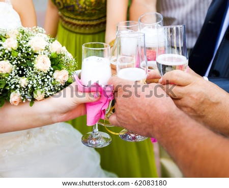People congratulating new married couple with Wedding Champagne - stock photo