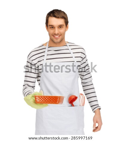people, cooking, culinary and food concept - happy man or cook in apron with baking and kitchenware - stock photo