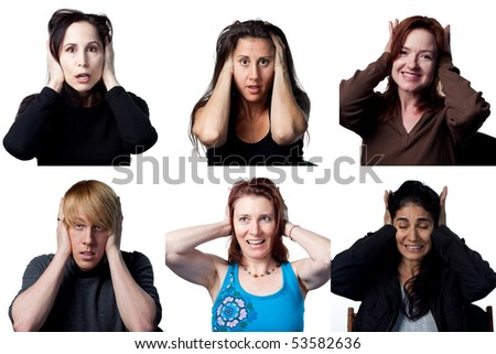 People covering their ears due to some loud noise - stock photo
