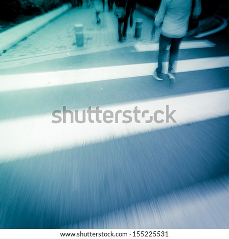people crossing street - stock photo