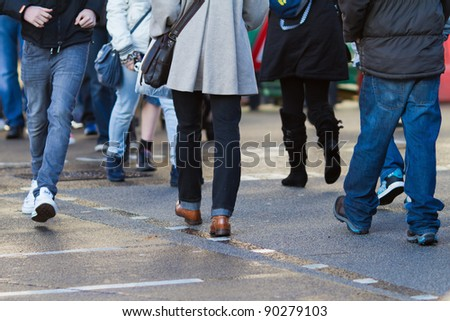 people crossing the street - stock photo