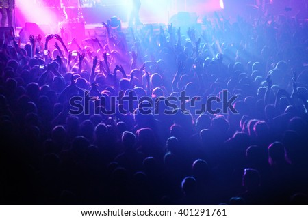 People crowd in concert lights - stock photo