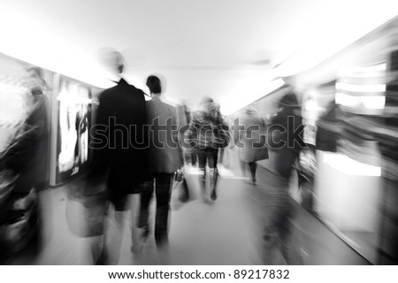 People crowd in motion, city scene - stock photo