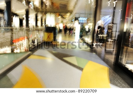 People crowd motion at shopping mall - stock photo