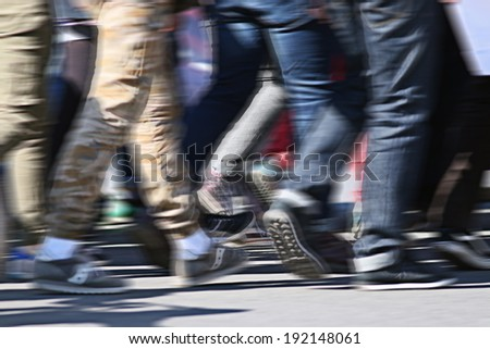 People crowd walking back foot blurred background - stock photo