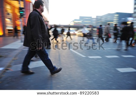 People crowd walking in the city - stock photo