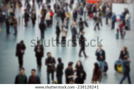 People crowd  walking, intentionally blurred background post production - stock photo