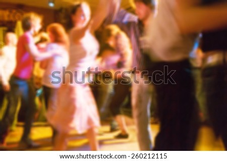 People dancing at the party abstract blur background with bokeh - stock photo