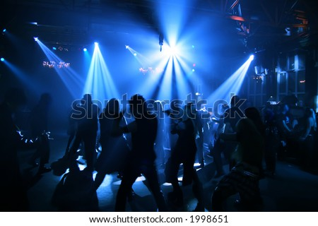 People dancing in a disco - stock photo