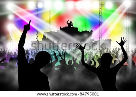 People dancing in night club. DJ playing music - stock photo