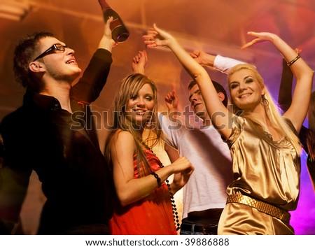 People dancing in the night club - stock photo