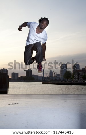 People dancing with Rotterdam on the background - stock photo