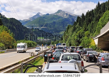 People delayed by large traffic jam on highway - stock photo
