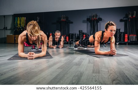 People doing push ups in fitness class - stock photo