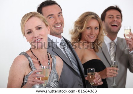 People drinking champagne - stock photo
