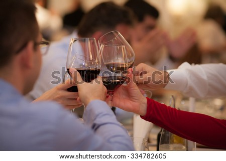 People drinking wine at a party