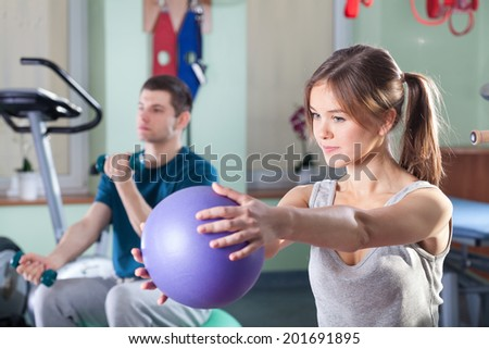 People during physical exercises at rehabilitation room - stock photo