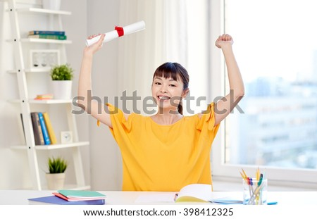 people, education, school, graduation and learning concept - happy asian young woman student with diploma scroll celebrating at home - stock photo