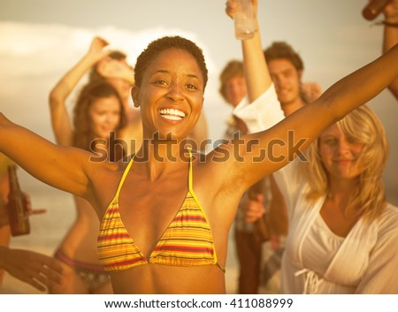 people enjoying a summer beach party. - stock photo