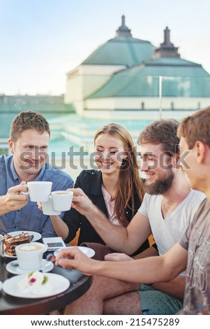 people enjoying coffee together (focus on woman's eyes)