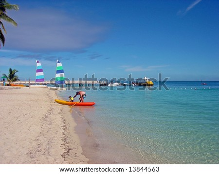 People enjoying the beach at Plantation Island Resort, Malolo Island, Fiji. - stock photo