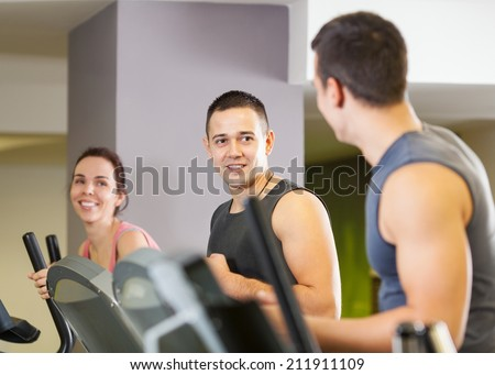People exercising in a gym - stock photo