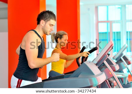 people exercising in the gym