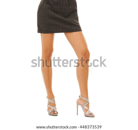 people, fashion and beauty concept - close up of woman legs in high heel shoes over white background