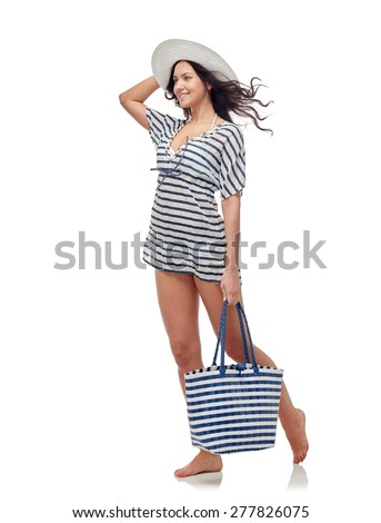 people, fashion, summer and beach concept - happy young woman in bikini swimsuit and sun hat - stock photo