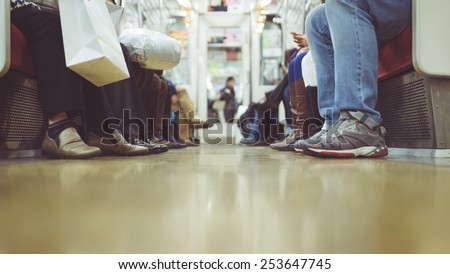 people feet view in tokyo metro commuter. ground view - stock photo