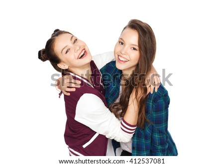people, friends, teens and friendship concept - happy smiling pretty teenage girls hugging