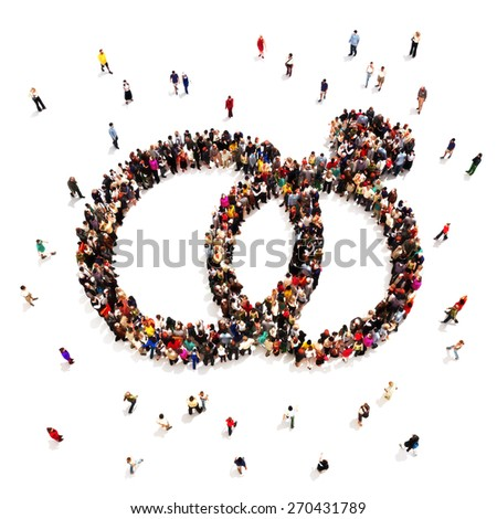 People getting engaged or married. Large group of people in the shape of wedding rings on a white background. - stock photo