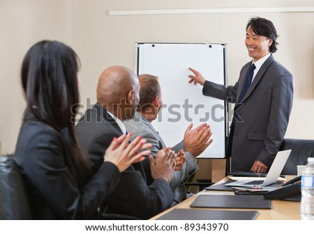 People giving applause after speech of a businessman at the conference - stock photo