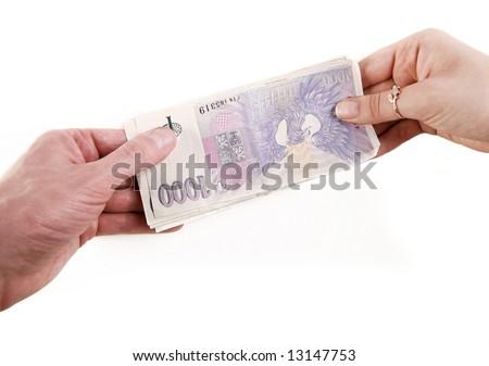 People giving eachother money. - stock photo