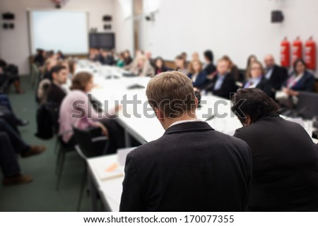 people giving presentation at conference - stock photo