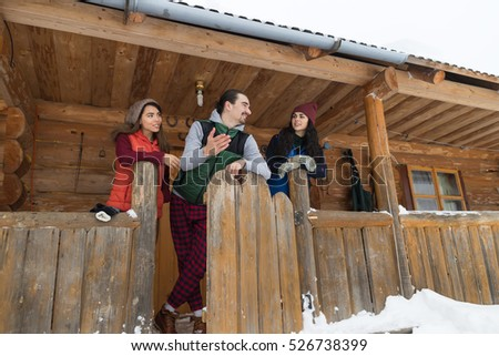 People Group Wooden Country House Winter Snow Mountain Resort Cottage Friends Talking On Vacation