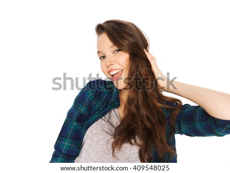 people, hair care, style and teens concept - happy smiling pretty teenage girl touching her head - stock photo