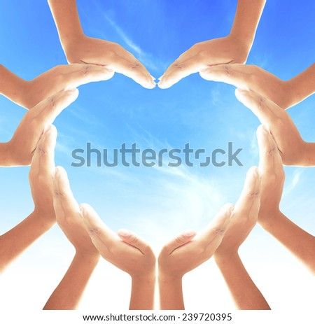 People hand heart shape on blurred ocean, blue sky cloud background. World Mental Health Care Dignity Insurance Love Unity Investment Pray Valentine Christmas Generosity Harmonious Blessing concept - stock photo