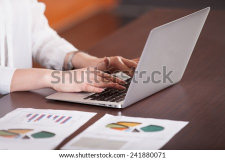 people hands typing on laptop keyboard - stock photo